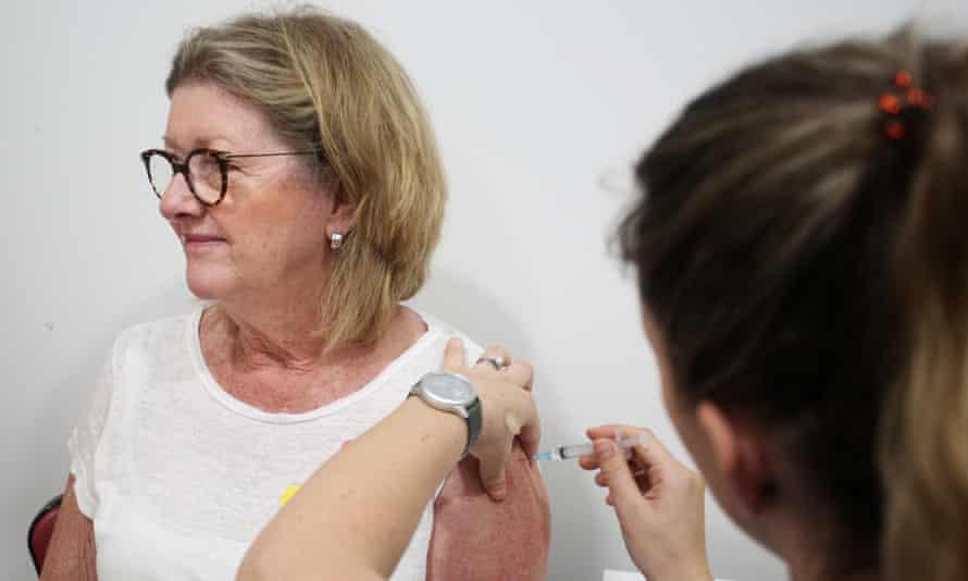 Dawne Yeates receives the AstraZeneca vaccine from nurse Emma McCallum at the Sydney Road Family Medical Practice in Sydney, Australia