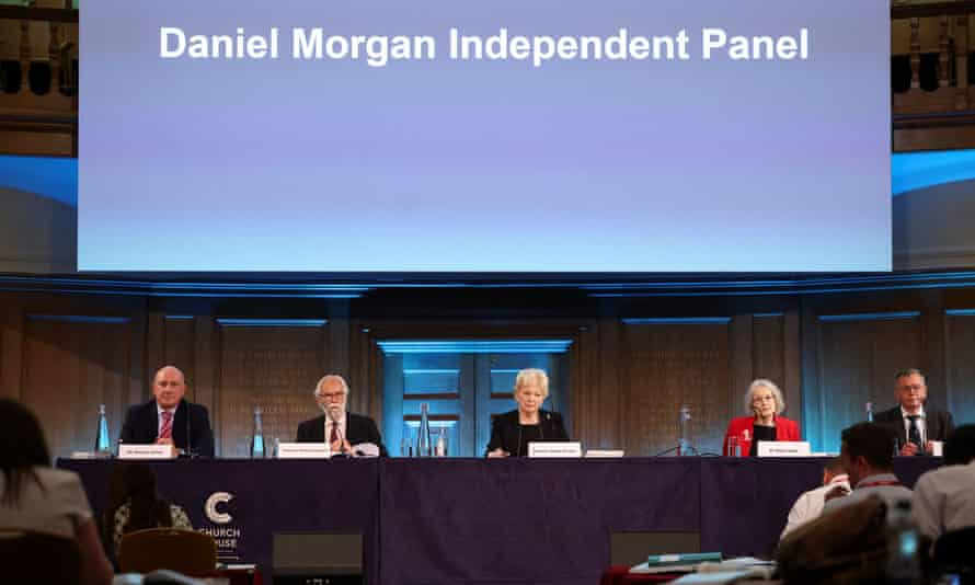 Panel members prepare to read out a statement following the publication of their report
