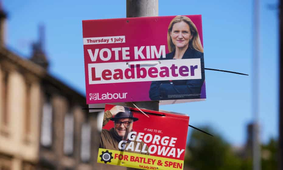Campaign posters on lampposts in Heckmondwike ahead of next week's Batley and Spen byelection