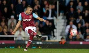 Dimitri Payet gives his free-kick some gusto but it's straight into the United wall