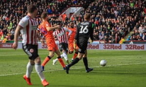 Gary Madine slots the ball home in the 51st minute to give Sheffield United the lead.