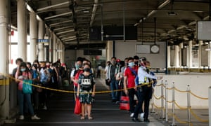 Passengers queue to go to the train platform in Manila, Philippines.