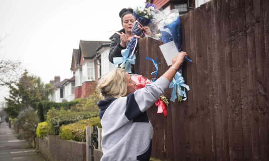 Friends and family of Henry Vincent attach flowers to a fence in Hither Green, near where he died.