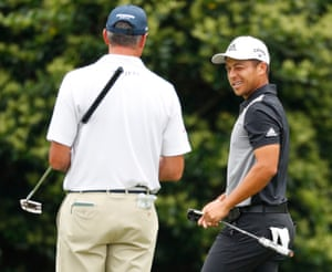 Xander Schauffele is surging up the leaderboard. He's pictured here winking at Matt Kuchar after a birdie on the 11th.