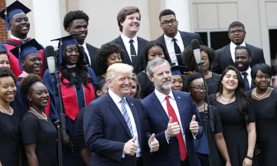 President Donald Trump poses with Liberty University president, Jerry Falwell Jr. in 2017.