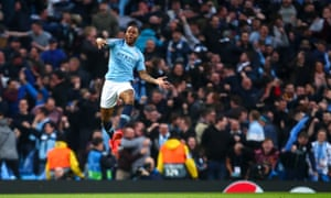 Manchester City's Raheem Sterling celebrates scoring their first goal.