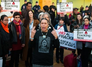 An indigenous woman speaks during an anti-fracking demonstration