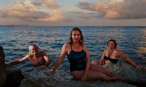Night-swimmers  Keith Cummings, Susanne Master and Amanda Cook at Hengistbury Head, Dorset