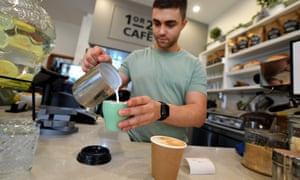 A barista is seen preparing a coffee at a cafe in Canberra, Thursday, Feb. 23, 2017.