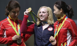 Virginia Thrasher, centre, holds her gold medal for the women's 10m air rifle competition, with China's runner-up Du Li, left, and third-placed Yi Siling.
