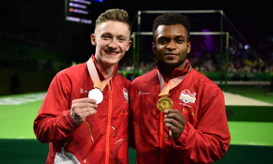 Silver medallist Nile Wilson (left) and gold medallist Courtney Tulloch following the gymnastics men's rings final at the Commonwealth Games.