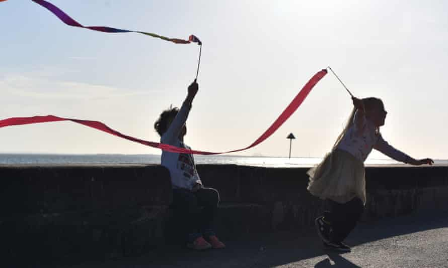 Two children play with their ribbon wands on a warm sunny Easter Sunday at Chalkwell beach.
