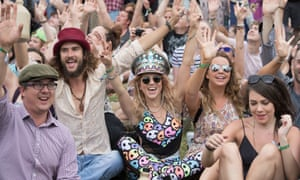 Some of the people forming the peace sign at Glastonbury.
