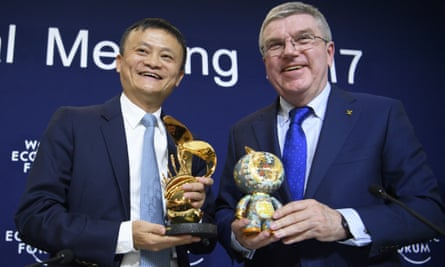 The IOC president Thomas Bach, right, and Jack Ma, executive chairman of the Alibaba Group, on Thursday.