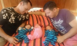 David and Nicky Beard with their surrogate triplings.