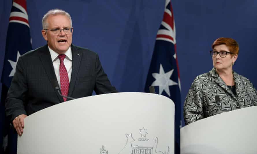 The Australian prime minister, Scott Morrison, pictured with defence minister Marise Payne, says the rate of coronavirus infection in India is 'rapidly escalating'