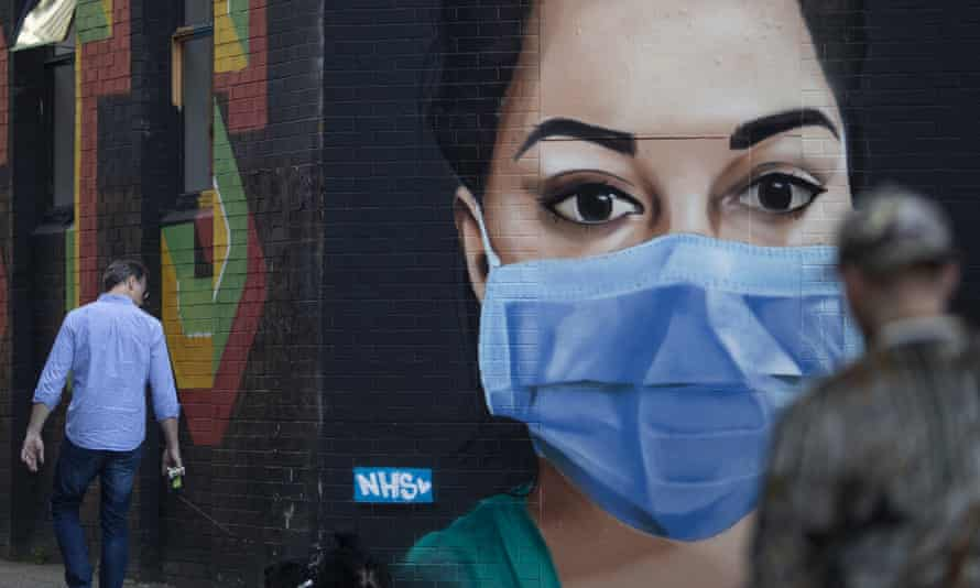 Street art depicting an NHS nurse wearing a face mask in London.