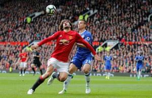 Manchester United's Marouane Fellaini beats Chelsea's Cesar Azpilicueta to the ball