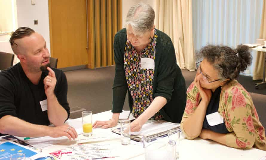 Three teachers discussing ideas over a table of documents at Doing News CPD, Guardian Education Centre and English and Media Centre, 27 June 2019