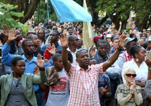Residents attend a prayer meeting called to celebrate after Mugabe was dismissed