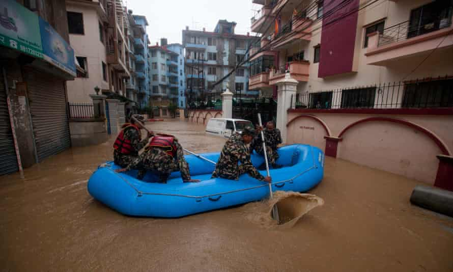 Nepalese army personnel rescue local people after a heavy rainfall in Kathmandu, Nepal