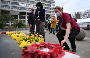 Medical staff lay flowers outside St.Thomas's hospital following a minute of silence