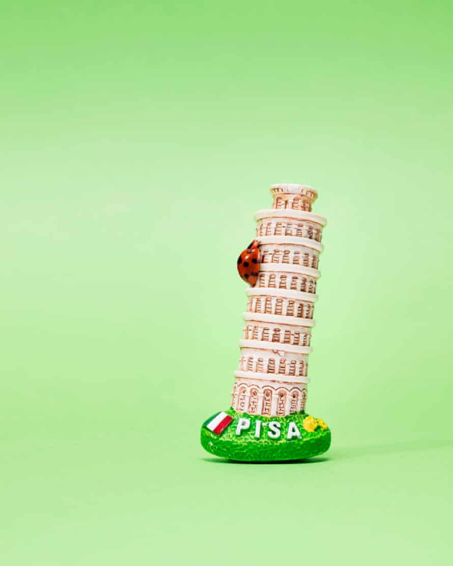 Ladybird climbing model of leaning tower of Pisa