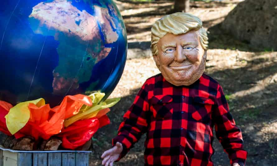Oxfam activists portrayed the G7 leaders, including US President Donald Trump, standing next to a burning Earth during the G7 Summit in Quebec City, Canada in June 2018.