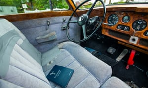 The interior of Elvis Presley's Rolls-Royce complete with red telephone.