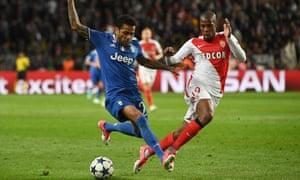 Juventus's Dani Alves, left, holds off Monaco's Djibril Sidibe during the Champions League semi-final first leg.