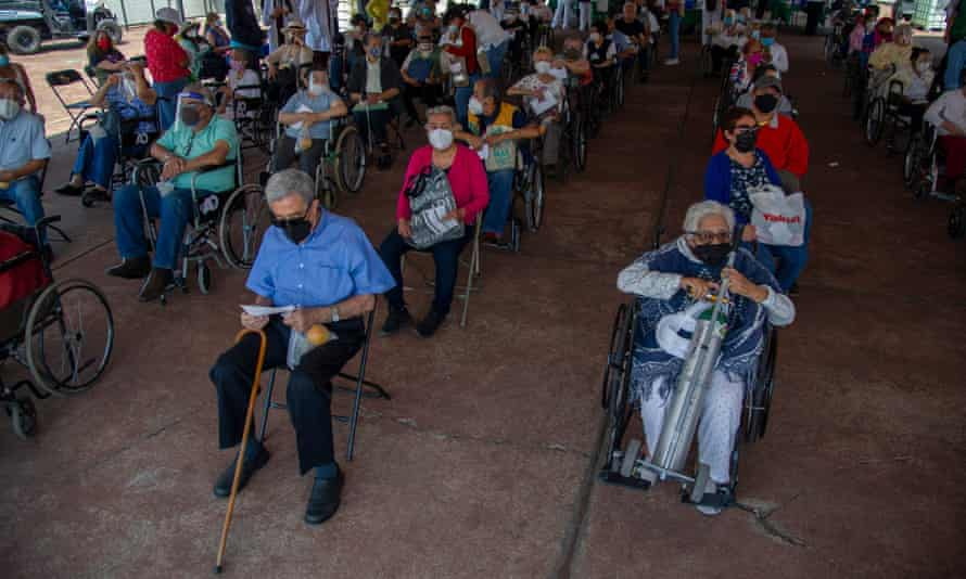 Elderly patients wait after receiving doses of the AstraZeneca vaccine against COVID-19 at a vaccination center set up at the University Olympic Stadium in Coyoacan neighborhood, in Mexico City.