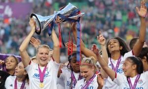 Ada Hegerberg lifts the trophy for Lyon.