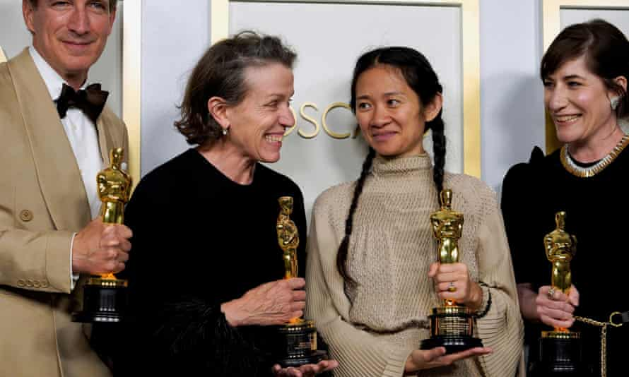 Frances McDormand and Chloe Zhao with their Oscars for Nomdland.