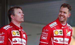 Sebastian Vettel cannot contain his joy at winning the Monaco Grand Prix as he stands on the podium next to his seemingly less than amused team-mate Kimi Raikkonen, who was second.
