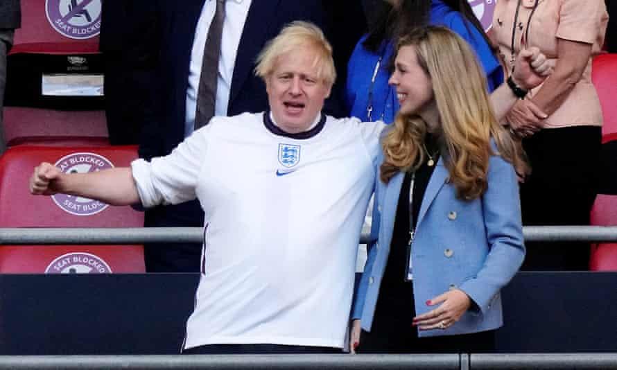 Boris Johnson at the Denmark semi-final with his wife, Carrie Johnson.