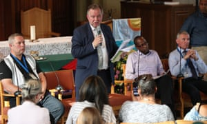 Barry Quirk, centre, speaks during the public meeting with Grenfell Tower residents at the Notting Hill Methodist church.