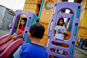 Children in a playground next to the makeshift school