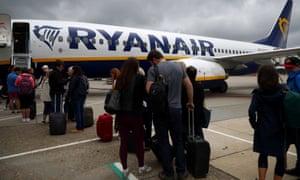 Passengers wait to board a Ryanair flight at Gatwick.