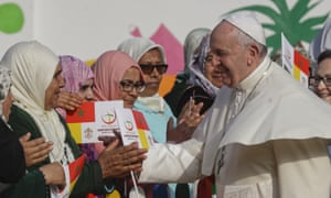 Pope Francis greets women in Morocco, as part of a trip aimed at showing solidarity with migrants at Europe's door.