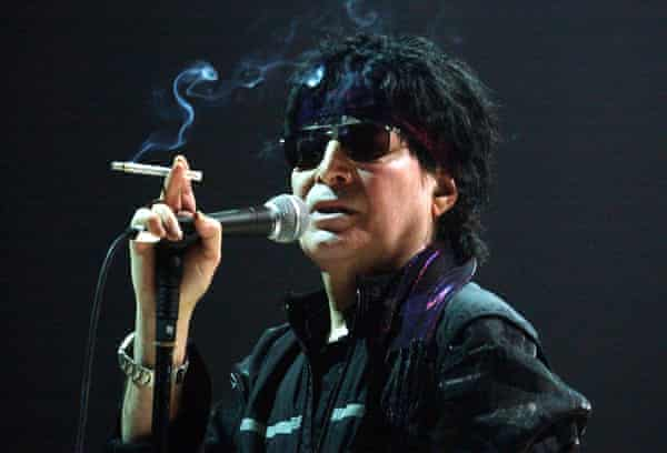 (FILES) This file photo taken on March 5, 2004 shows US singer Alan Vega performs in the western French city of Nantes as part of the I.D.E.A.L. Festival. According to the family, the singer of iconic New York proto-punk band Suicide passed away peacefully in his sleep July 16, 2016 at the age of 78. / AFP PHOTO / FRANK PERRYFRANK PERRY/AFP/Getty Images