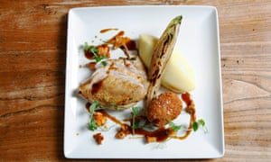 Chicken breast, girolles and leg Kiev on a square white plate with mash and drizzle