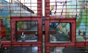 Locked gate at the entrance to the former children's charity Kids Company