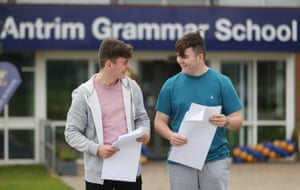 Twin brothers Ross (left) and Scott Makay (right), 16, pick up their GCSE results at Antrim Grammar School in Northern Ireland