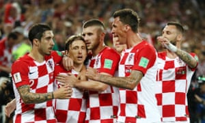 Luka Modric celebrates with his teammates after scoring the second.