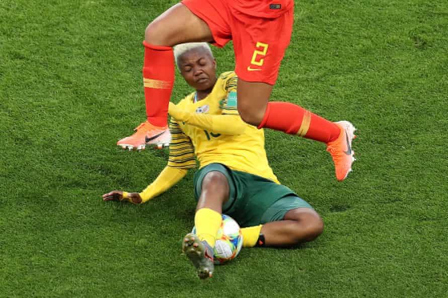 Bambanani Mbane of South Africa slide tackles Liu Shanshan of China during a group B match between South Africa and China PR at Parc des Princes.