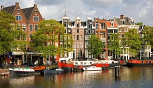 Row of houses along the Amstel River in Amsterdam