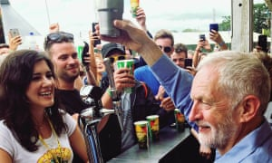 Picture taken with permission from the twitter feed of @HazelJN of Labour leader Jeremy Corbyn pouring a drink at the Solstice Bar during Glastonbury Festival (2017).