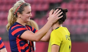USA midfielder Lindsey Horan talks to Australia's forward Caitlin Foord after the USWNT secured bronze.