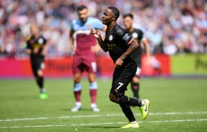 Raheem Sterling of Manchester City celebrates after scoring his team's third goal.
