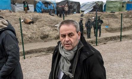 President of Nord-Pas-de-Calais regional council Xavier Bertrand at the 'Jungle' camp in Calais